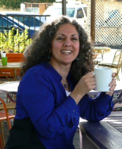 See this grin? That's me, sharing creative works and ideas with you, and a cup of tea.